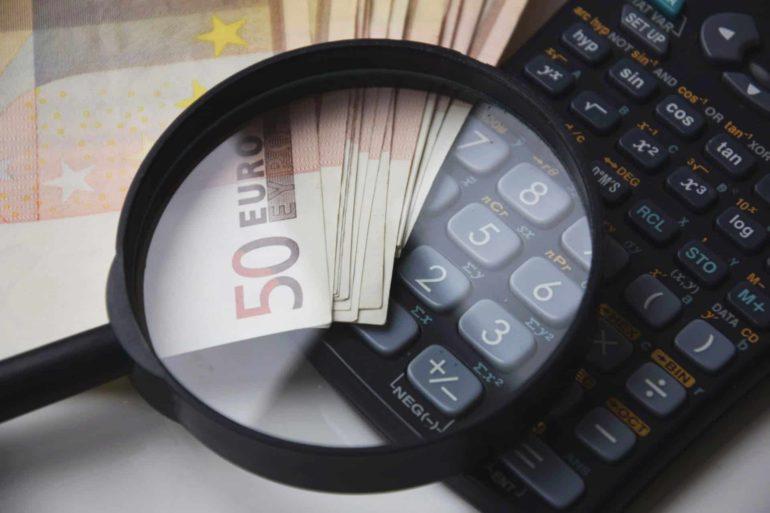 geld vergrootglas rekenmachine